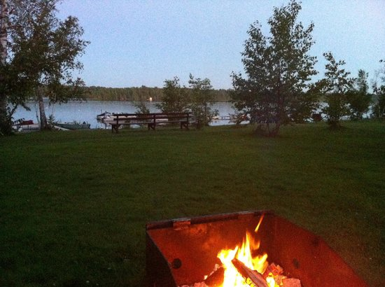 Miller's Family Camp: Private campfire in front of our cabin, right beside the lake