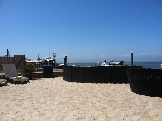 The Palms Hotel Fire Island: Back of Palms Bay East Hotel - relaxing on the lounge chair