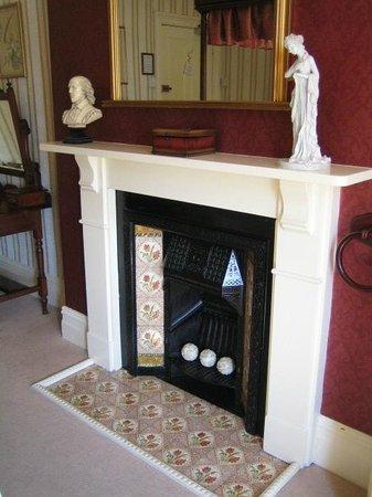 Cranleigh: Fireplace in bedroom