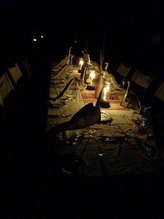 Luwi Bush Camp - Norman Carr Safaris : Romantic evening dining setting