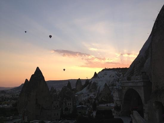 Village Cave House Hotel: Watching hot air balloons float by at dawn from the terrace