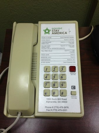 Extended Stay America - Atlanta - Alpharetta - Rock Mill Rd.: Yellow phone.  Time to replace them when they look this old.