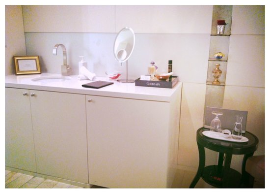 Guerlain Spa: Sink area in private treatment suit, fully stocked with Guerlain products.