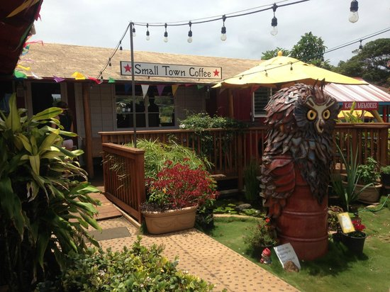 Small Town Coffee: iron owl structure greets coffee-lovers