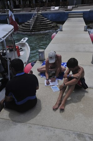 Diving Adventures: Felipe helpng my son fill out his logbook