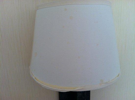 Embassy Suites by Hilton Tysons Corner: Falling apart lampshade in bedroom, splatters on it looks like blood.
