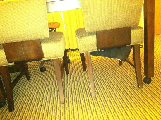 Embassy Suites by Hilton Tysons Corner: Underneath of chair unraveling. Chairs dirty n stained.