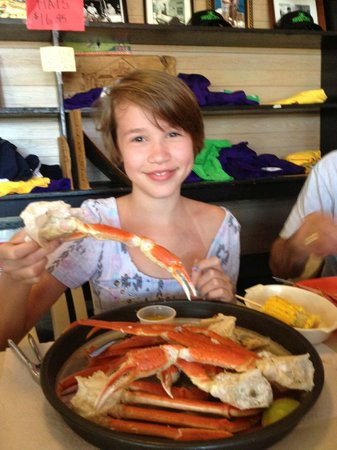Indian Pass Raw Bar: Granddaughter with plate of crab legs.