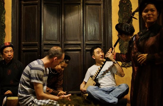 Thang Long Ca Tru Guild : The audience are taught how to play the instruments.  Good thing they didn't ask us to sing.