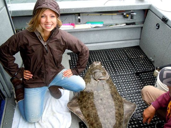 Ear Mountain Charters: My 16 year old who pulled in a 165 lb Halibut. Captain Eric helped the entire time!