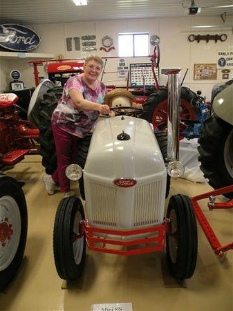 "Wheels O' Time Museum: Here I am (4'11"") with a tractor just MY size!  Who knew?"