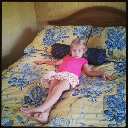 Colonial Gables Oceanfront Village: My daughter chilling on one of the beds.