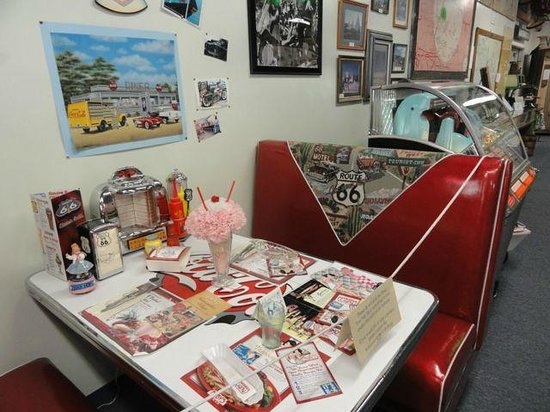 The California Route 66 Museum: Booth from an old diner. Have your picture taken here.