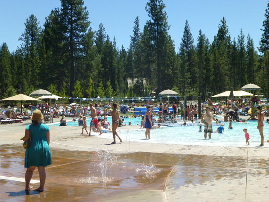 Sunriver Homeowners Aquatic & Recreation Center: Outdoor pools (seasonal) with 2 water slides in background