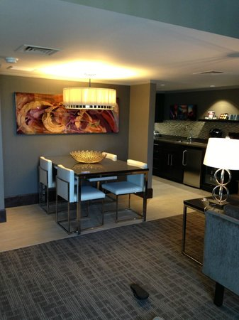 Oasis Hotel and Convention Center, an Ascend Hotel Collection Member: dining area in  suite