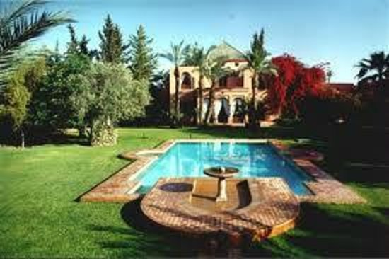 Dar Ayniwen Villa Hotel: The pool and main building.