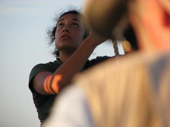 Bay Sail: Crew woman checks the set of the peak.