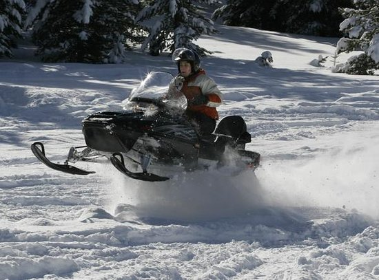 Granite Hot Springs: Catching air with Jackson Hole Snowmobile Tours