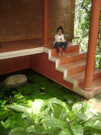 Edakkal Hermitage: Atulita outside the cottage