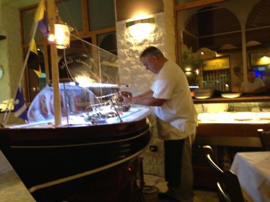Locanda Colibri: The cook grabbing fresh seafood to cook.