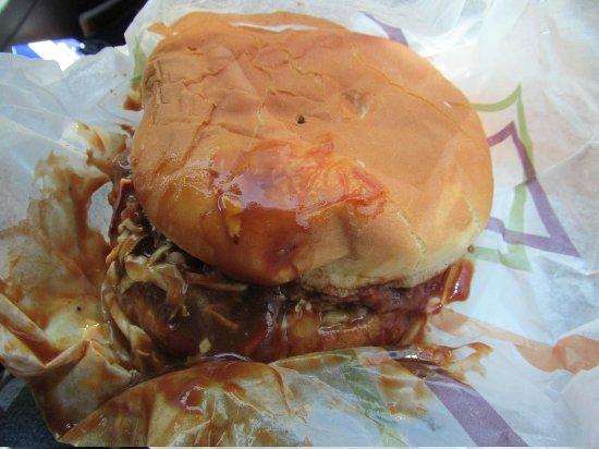 jumbo pulled pork sandwich with slaw on it