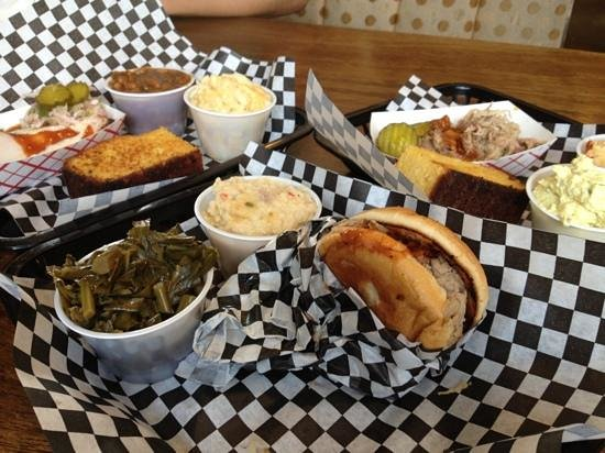 Moe's Original BBQ: pork sandwich turkey show stopper Mac cheese, grits, beans, corned toasts.