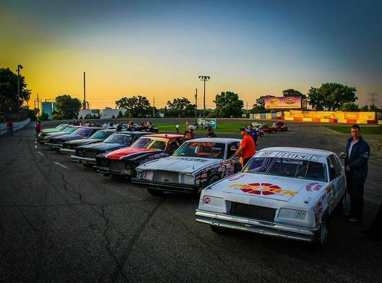 "Raceway Park: Lineup of ""Bomber"" race cars from this summer."