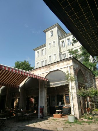 Caferaga Medresesi: Tall buildings around quiet down the noise