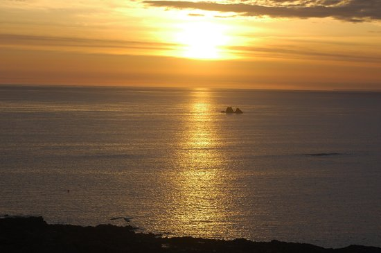 Highlands Hotel: sun set on longest day of the year at La Corbiere Light House