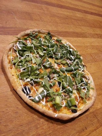 Pizza and Poutine Company: Mediterranean Pizza made with arugula, asparagus,chicken black olives and green onions