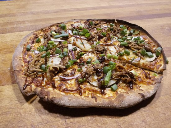 Pizza and Poutine Company: Stompin' Tom Pizza made with Island pulled pork, Island Potatoes, Jalapeño Bacon and red onions.