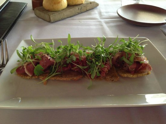 The Restaurant at Wente Vineyards: Lamb pastrami with coriander aioli, picked onions and unnamed greens on rye crisp