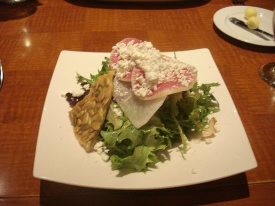 Mantles Restaurant & Lounge : Artisan greens (pumpkin sed brittle, goat cheese) thinly sliced radishes yummy!