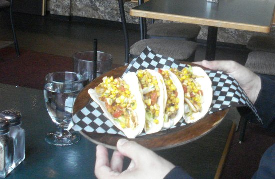 Masa's Bar & Grill : shredded chicken spiced chicken, stuffed into fresh corn tacos $13