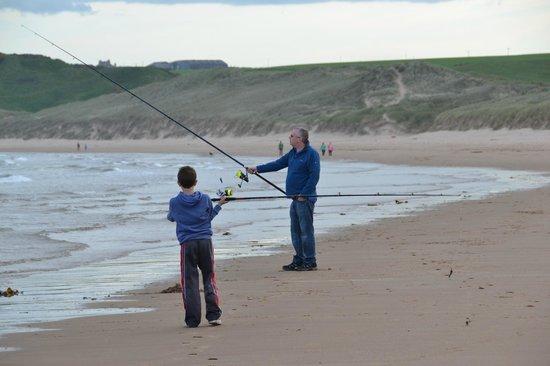 Cruden Bay Golf Club: Fishing on the beach beside Cruden Bay Golf Course