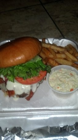 "Mr. C's Food & Spirits : Mr. C's ""Bubba Burger"" is complete with swiss cheese, bacon, lettuce, tomato, onion, and ""specia"