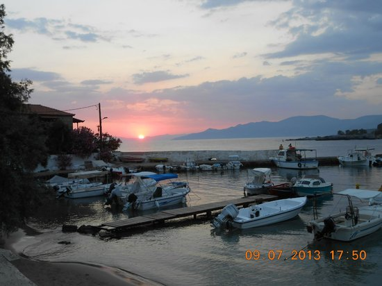 Akrogiali : View from our table at sunset, time on photo is uk time.