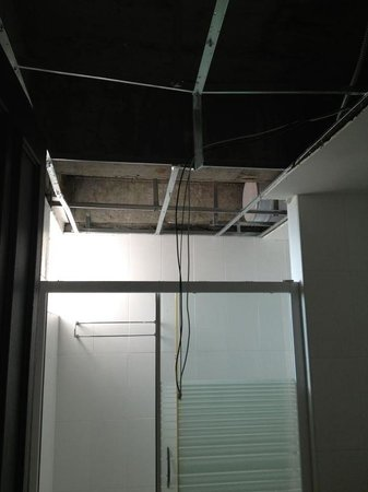 Alora Hotel: The ceiling after the crashed inside the bath room