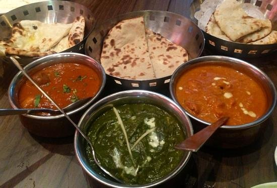 Aromas of India: butter chicken, lamb vindaloo and palak paneer.