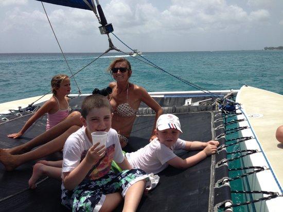 Small Cats Catamaran Sailing Cruises: Boys and friends enjoying the trampoline!