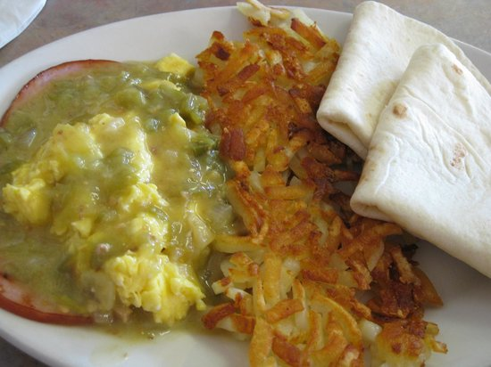 Our Place: Huevos Rancheros--ham, eggs your way, green chile sauce, hashbrowns and tortillas