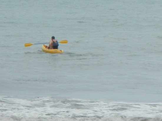 Tulemar Bungalows & Villas: My husband kayaking from the private beach