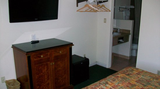 "Monterey Oceanside Inn: Flatscreen 40"" LED TV over cabinet & refrigerator (right of cabinet)"