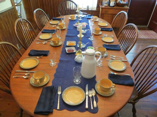 Breakfast table all set up for the guests - Picture of