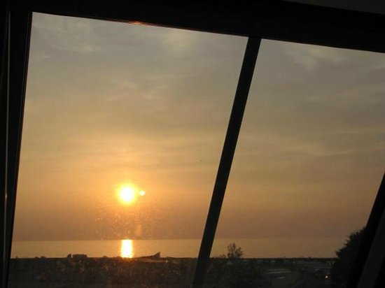 Carno House: Sunset from Sea View room.