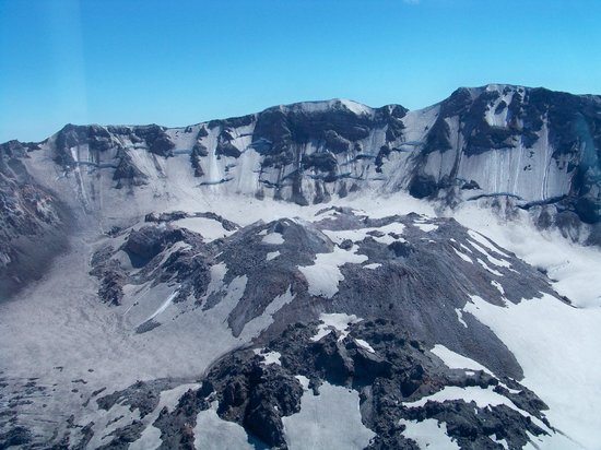 Mt St Helens Helicopter Tours: Mt. St. Helens dome. Small plumes of smoke towards center