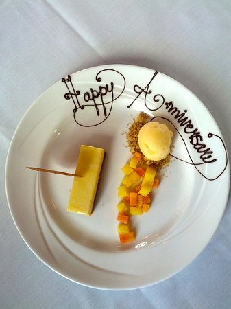Verses Restaurant : Lemon cheesecake with Ginger Cookie, Sorbert and Pineapple drizzle
