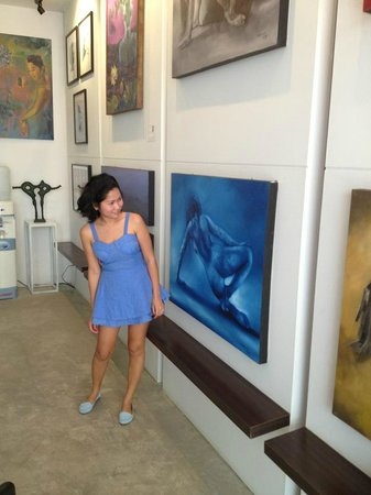 The Artist House : My wife enjoying art exhibition in the reception area.