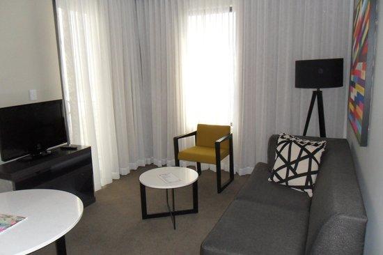 Adina Apartment Hotel Norwest: Living Room w/ Flat Screen TV, Sleeper Sofa