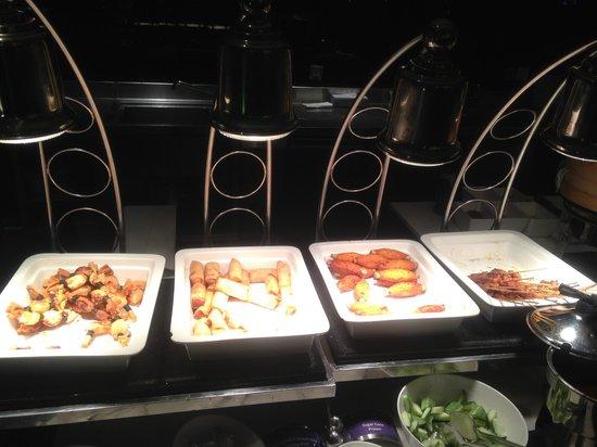Starz Restaurant: From left: Deep fried prawn moneybag, deep fried veggie spring roll, sugar cane prawn and Satay